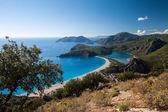 Oludeniz lagoon in sea landscape view of beach — Stock Photo