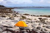 Tourist tent on ocean beach — Stock Photo
