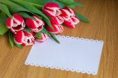 Fresh bouquet of tulips and a sheet of paper for writing text — Stock Photo