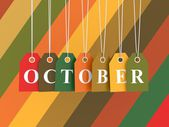 October tag on colored hanging labels. — Stock Photo