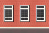 Three windows on red brick wall — Stock Photo