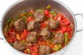 Meatballs cooking in a sauce — Stock Photo