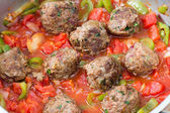 Metballs cooking in sauce — Stock Photo