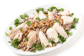Lebanese dish of chicken and spiced rice with nuts and parsley — Stock Photo