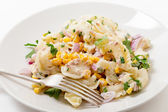 Plate of tuna and sweetcorn pasta salad — Stock Photo