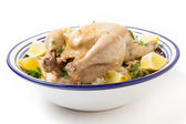 Chicken on pilaf rice in a Tunisian serving bowl — Stock Photo