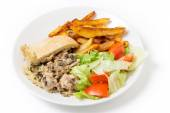 Chicken pudding dinner with fries and salad — Stock Photo