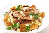 Chicken caesar salad side view — Stock Photo