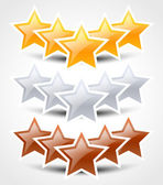 Gold, silver and bronze stars — Stock Vector