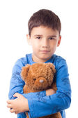 Boy hugging a teddy bear — Foto de Stock