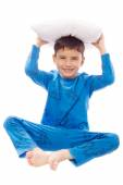 Boy in pajamas with a pillow — Stockfoto