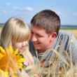 Father playing with his daughter in a wheat field — Stock Photo #52262709