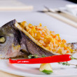Whole grilled fish stuffed with savory rice — Stock Photo #56261085
