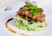 Marinated piquant sliced beef on savory rice — Stock Photo