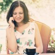 Woman chatting on her mobile phone — Stock Photo #56581099