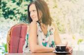 Woman drinking coffee outdoors — Stock Photo