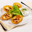 Постер, плакат: Potato Skins Appetizer Served in Restaurant