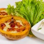 Постер, плакат: Potato Skins Appetizer with Cheese and Bacon
