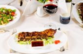 Glass of Wine Served with Ribs in Restaurant — Stock Photo