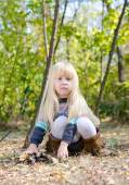 Adorable Little Girl Sitting on Forest Ground — Stock Photo