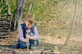 Cute Boy Playing at the Woodland During Autumn — Stock Photo