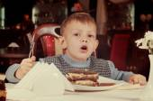 Cute little boy about to tuck into a slice of cake — Stock Photo