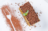Slice of Delicious Cake with Chocolate Shavings — Stock Photo