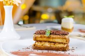 Gourmet Layered Cake on Plate with Cocoa Powder — Stockfoto