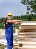 Builder selecting an insulated wall panel — Stock Photo