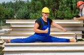 Funny fit worker in side split position at work — Stock Photo