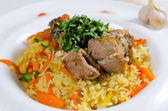 Savory saffron rice with meat and vegetables — Stock Photo