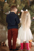 Rear View of Kids Decorating a Christmas Tree — Stock Photo