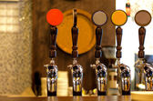 Row of Beer Taps in Bar — Stock Photo