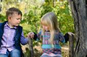 Kids Sitting on the Fence Holding on the Brace — Stock Photo