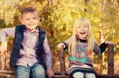 Happy Little Kids Sitting on a Wooden Garden Fence — Stock fotografie