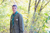 Portrait of Boy Scout in Forest on Sunny Day — Stock Photo
