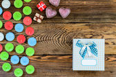 Candle with gift box and hearts — Stock Photo