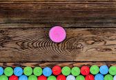 Annan färg ljus på träbord — Stockfoto