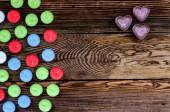Colorful Tealight Candles on Wooden Background — Stock Photo