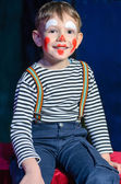 Cute excited little boy in comic red makeup — Stock Photo