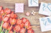 Bouquet of Tulips on Wooden Table with Presents — Stock Photo