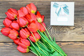 Tulips on Wooden Table with Little Gift Boxes — Stock Photo