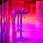 Row of Empty Bar Stools Along Bar in Night Club — Stock Photo #72888807