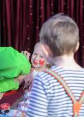 Boy Watching Girl Have Face Painted — Stock Photo