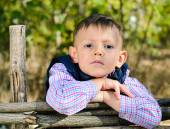 Boy Leaning on Arms on Top of Wooden Fence — Stock Photo