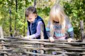 Kids in Autumn Outfit Playing at the Wooden Fence — Stock Photo