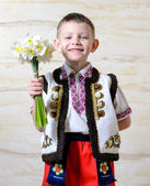 Adorable boy wearing traditional costume — Stock Photo