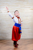 Little boy in colorful costume doing folk dancing — Stock Photo