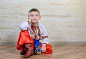 Inquiring boy with traditional folk costume — Stock Photo