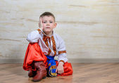 Inquiring boy with traditional folk costume — Stockfoto